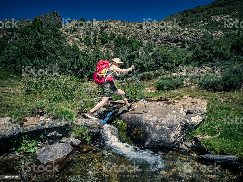 Woman trekking in the mountains stock photo