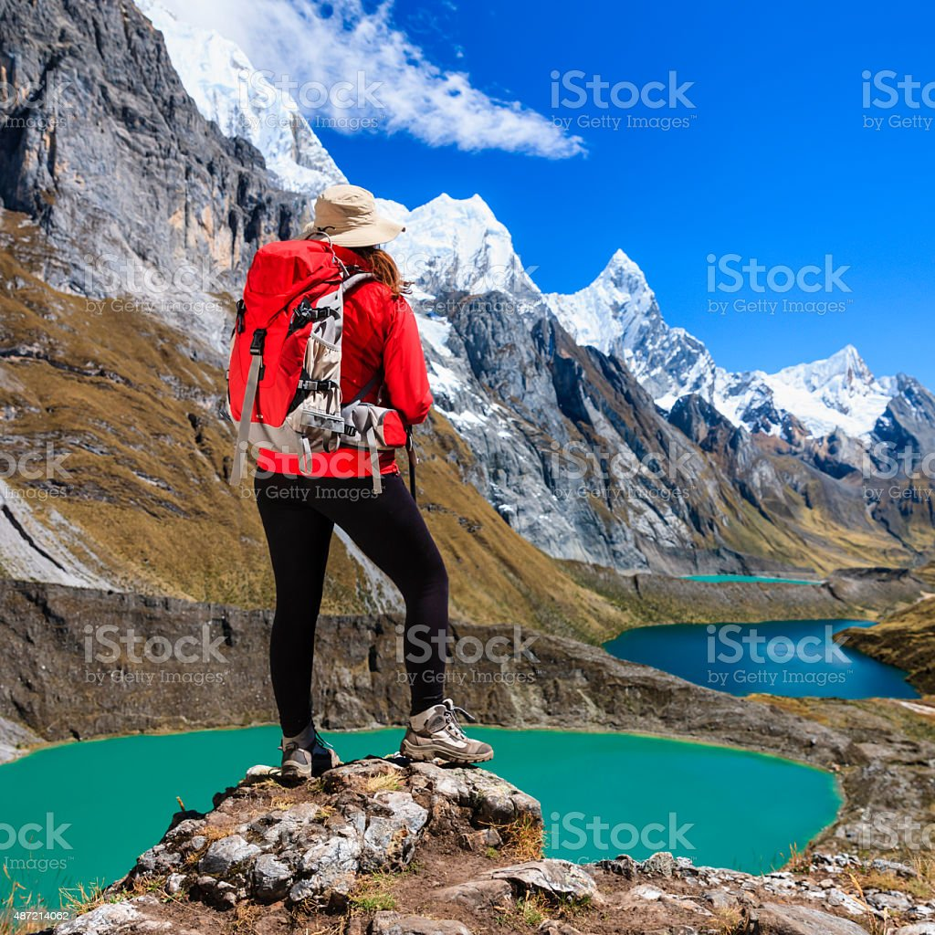 Woman trekking near Tres lagunas in Peruvian Andes, South America stock photo