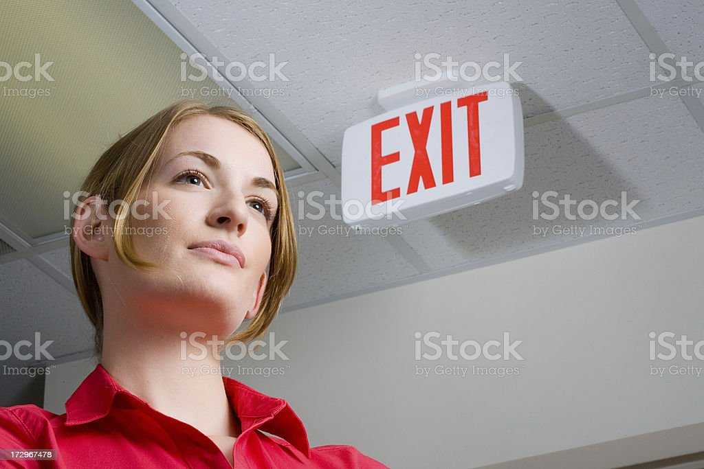 Woman tries to plan an escape royalty-free stock photo
