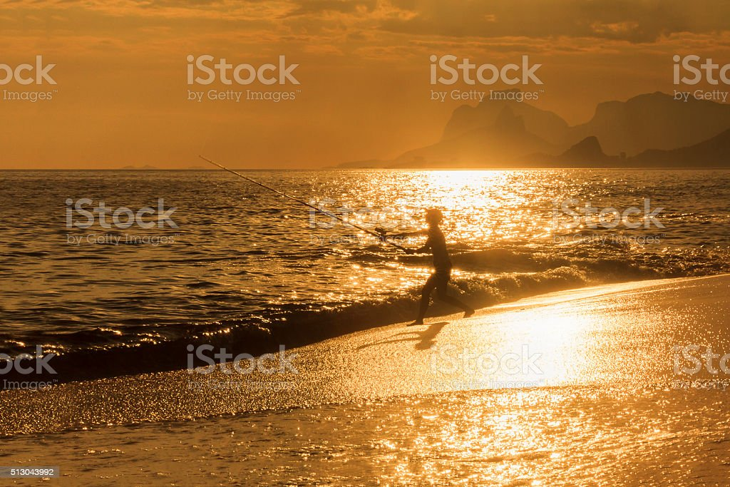 Woman Trowing Bait Against Bright Sunlight Reflection stock photo