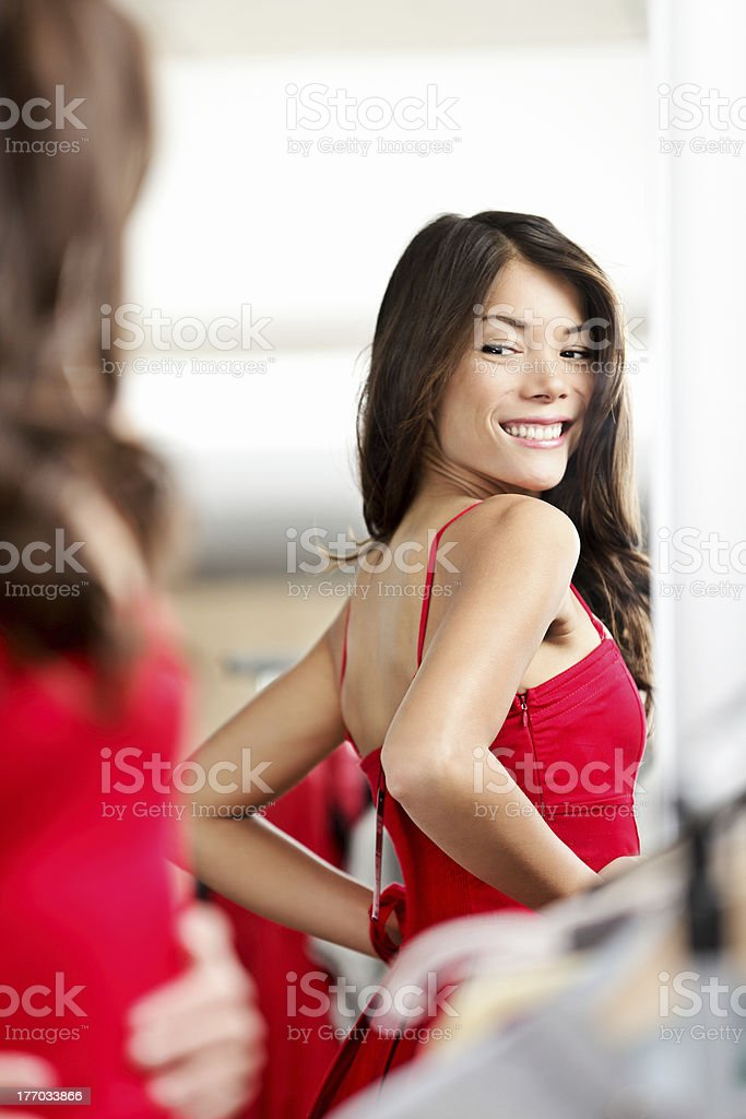Woman trying clothes / dress stock photo