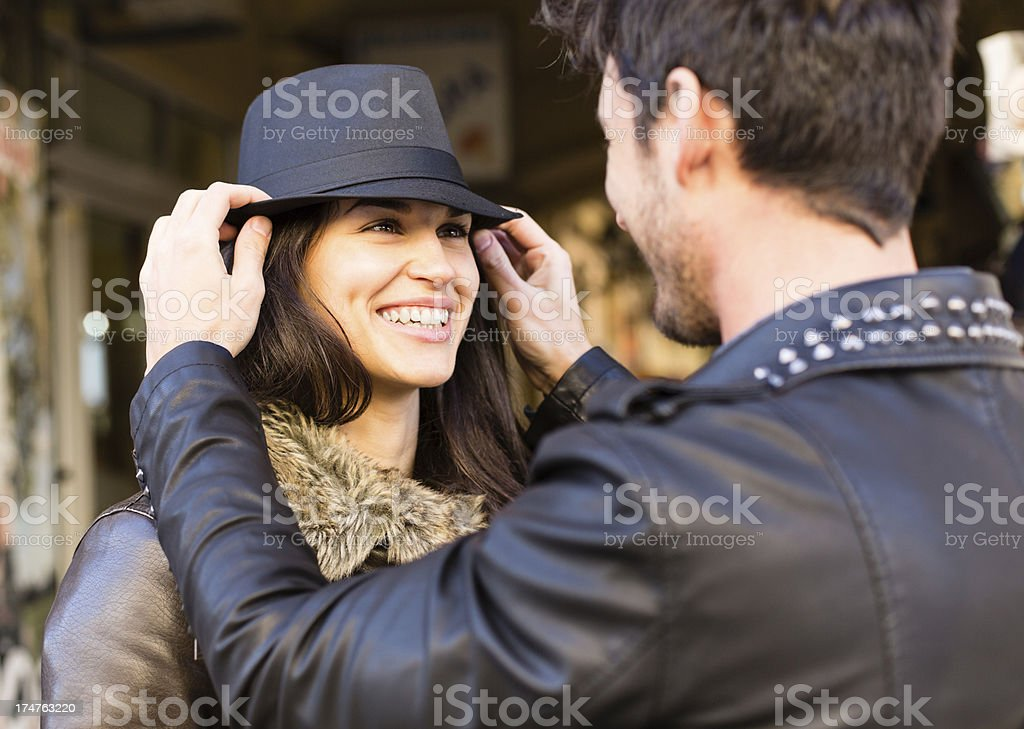 Woman trying on a hat stock photo