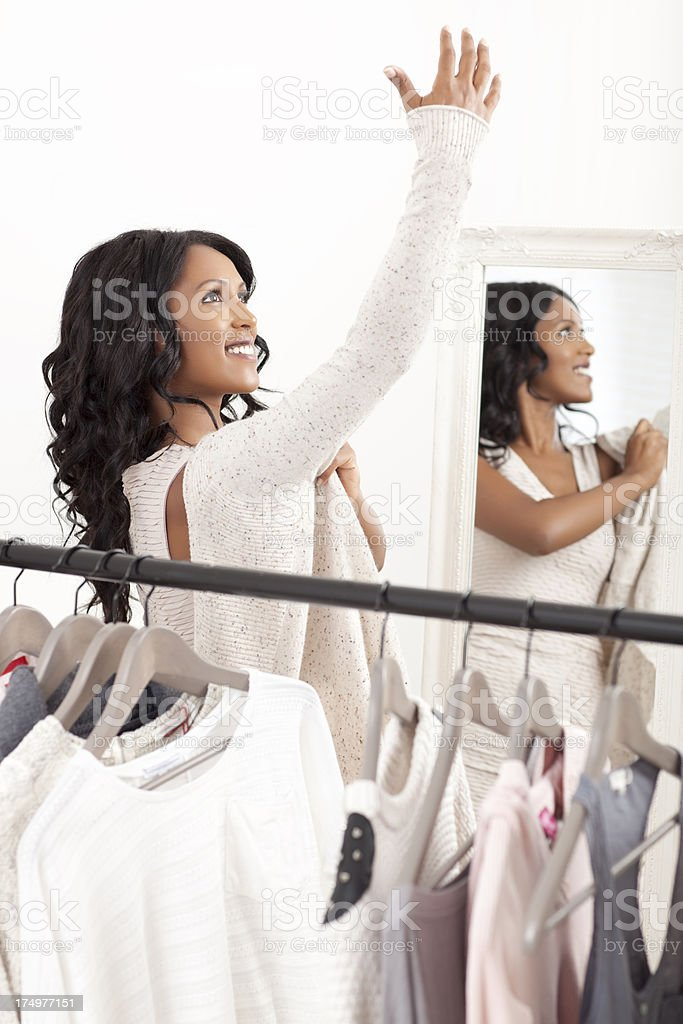 Woman trying on clothes. stock photo