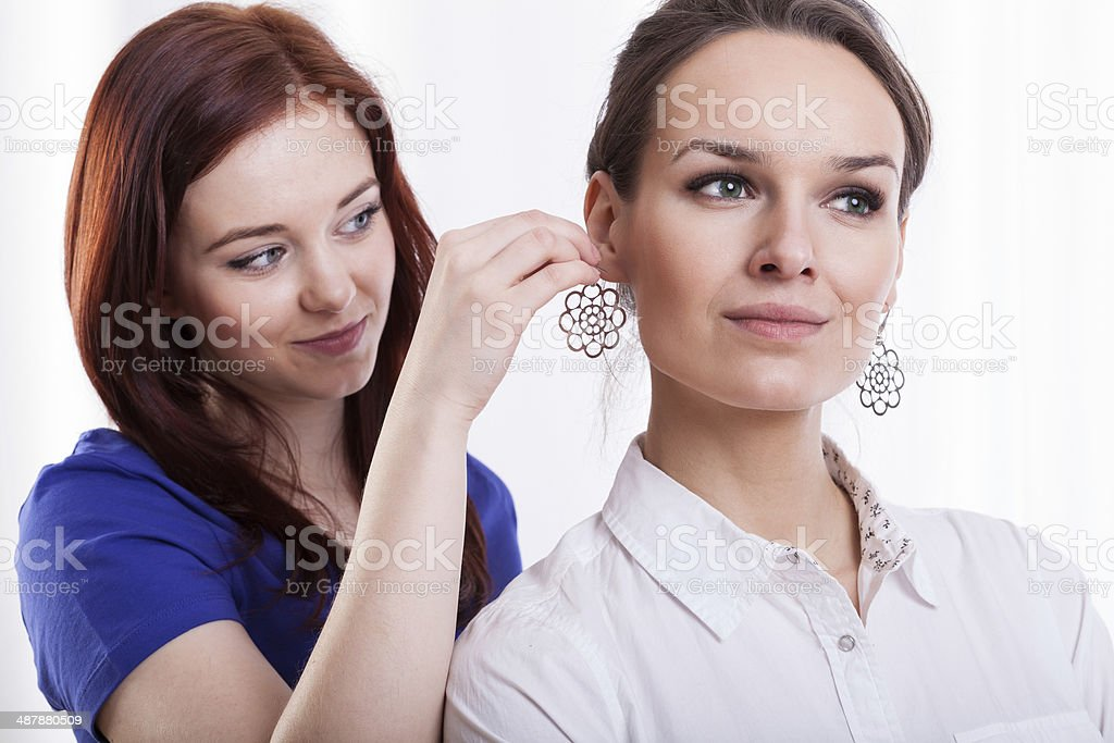 Woman trying on earring royalty-free stock photo