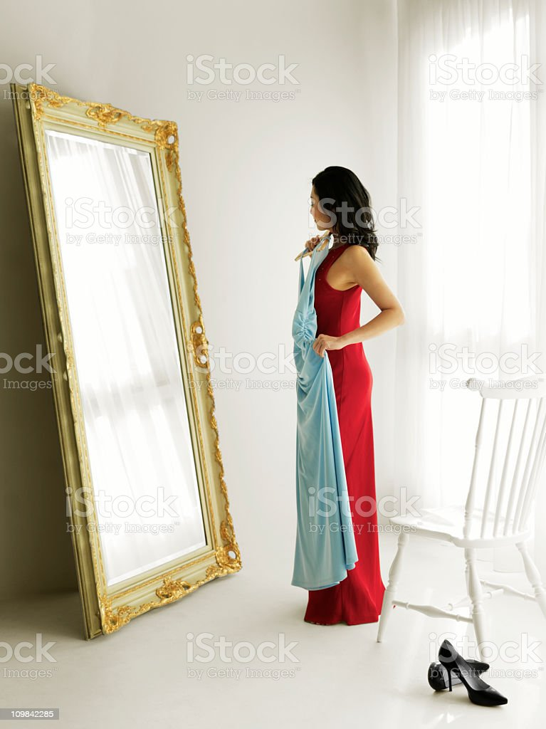 Woman Trying on Evening Gowns royalty-free stock photo