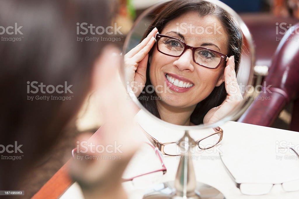 Woman trying on eyeglasses stock photo