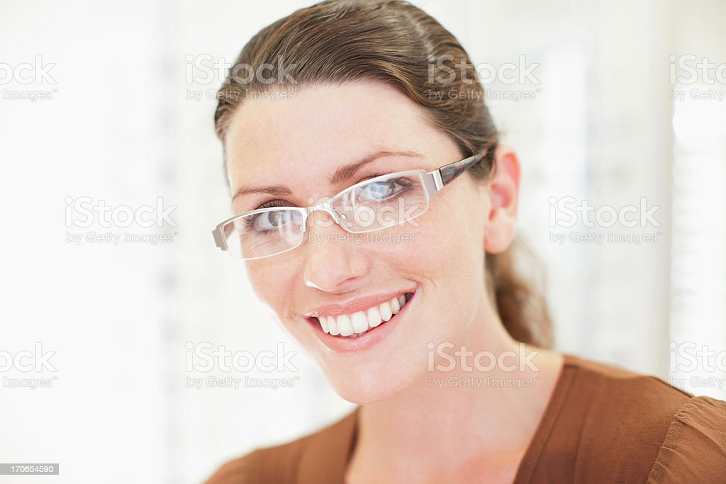 Woman trying on glasses in optometrist's shop royalty-free stock photo