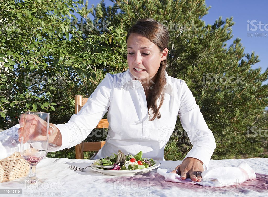 Woman trying to clean after spilling wine royalty-free stock photo