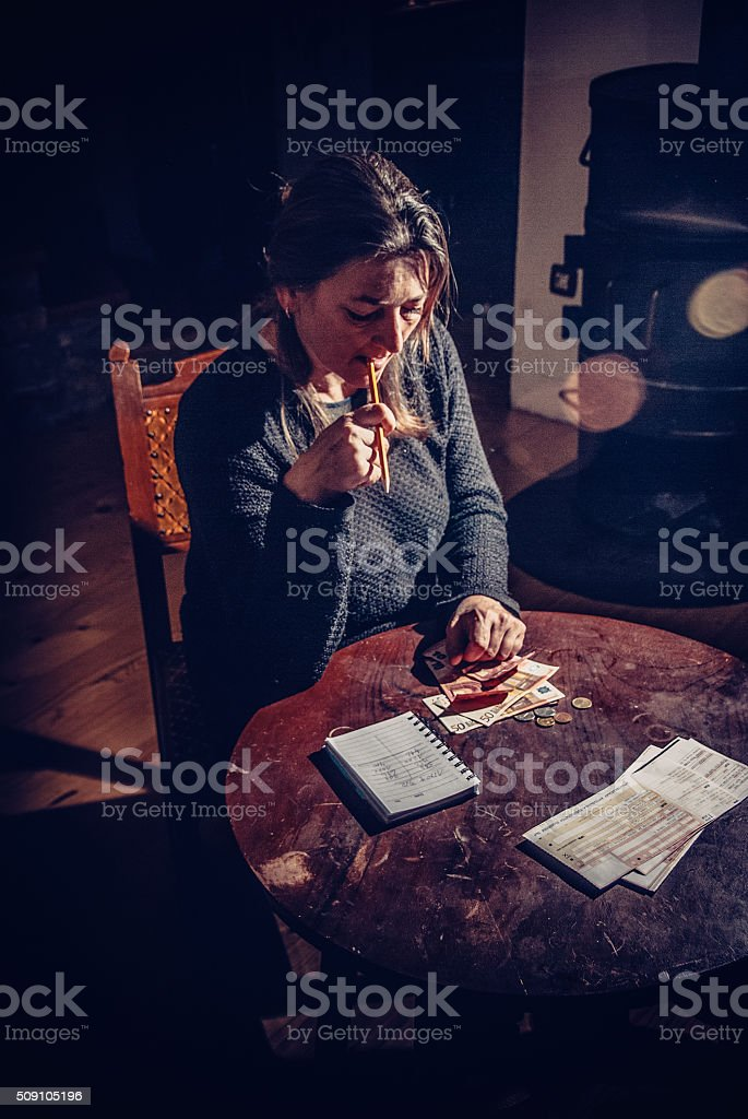 Woman Trying to Find a Solution to Pay Bills stock photo