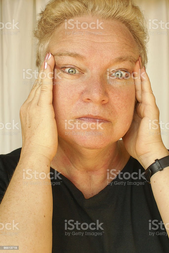 Woman trying to hide her wrinkles stock photo
