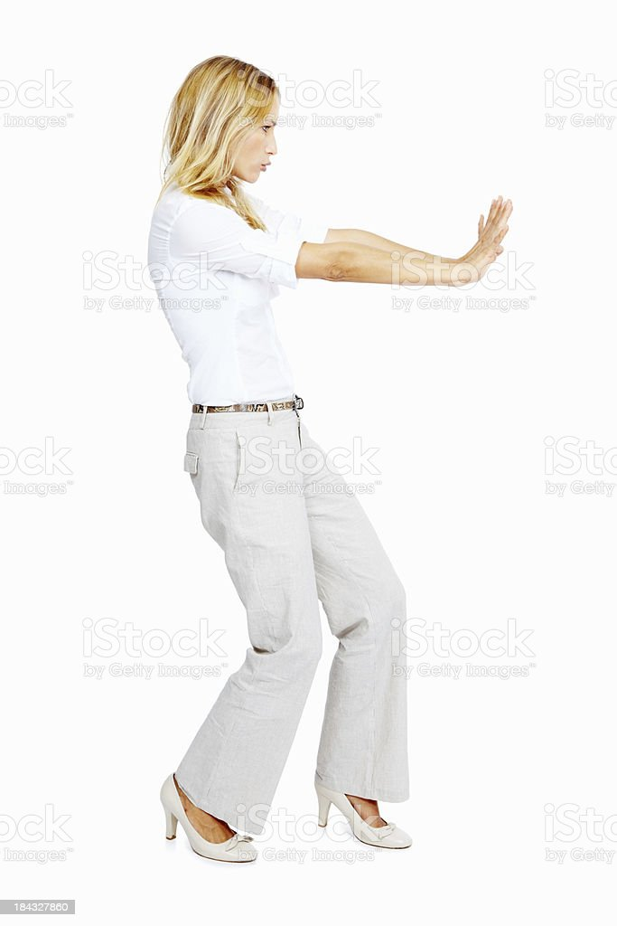 Woman trying to push something royalty-free stock photo