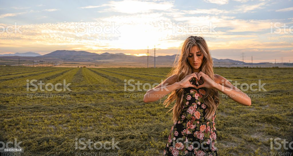 Woman turning away from heart shape stock photo
