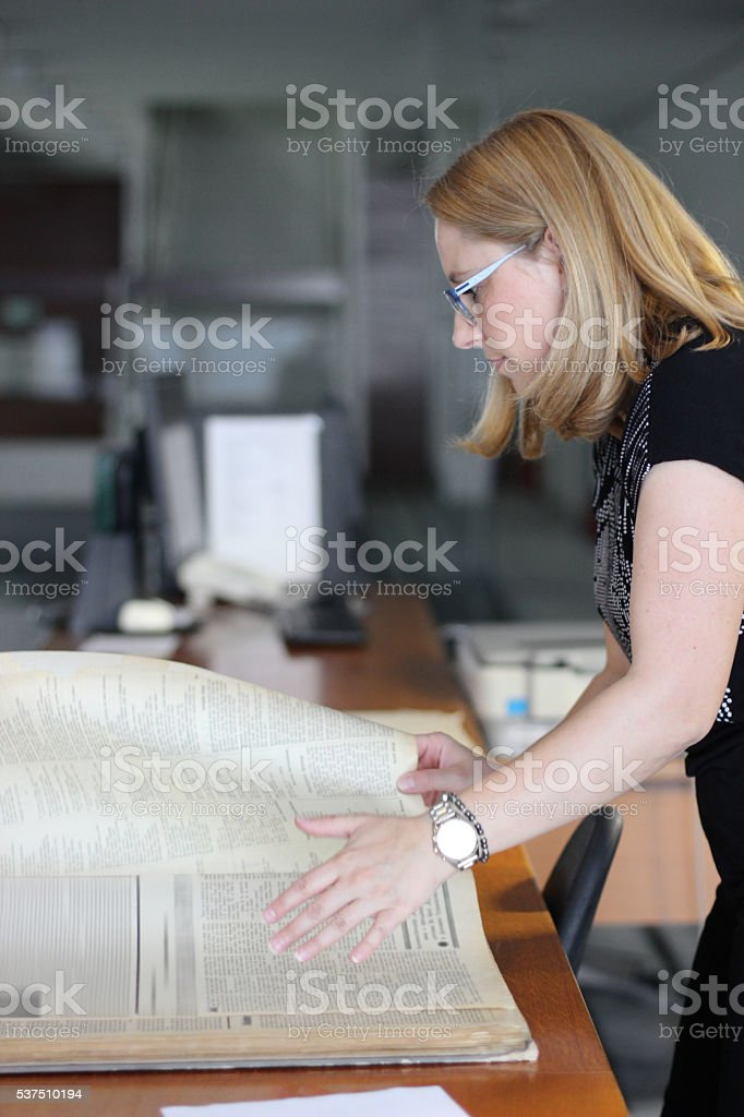 Woman turning pages stock photo