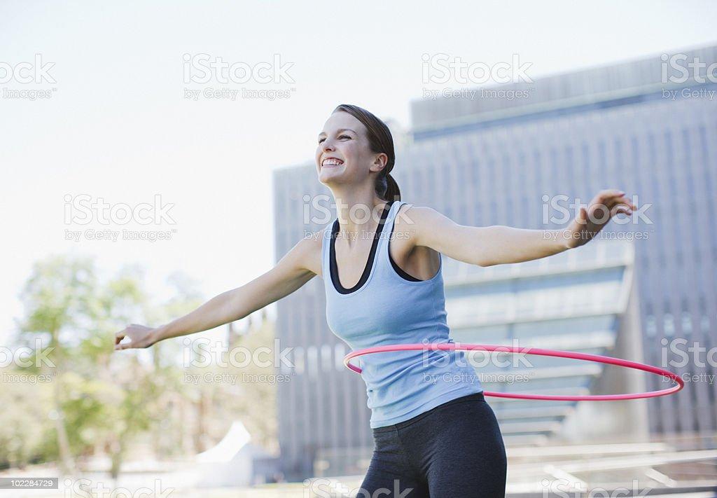 Woman twirling hula hoops stock photo