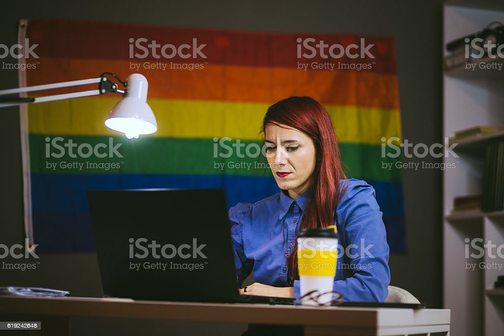 Woman Typing at Her Laptop stock photo