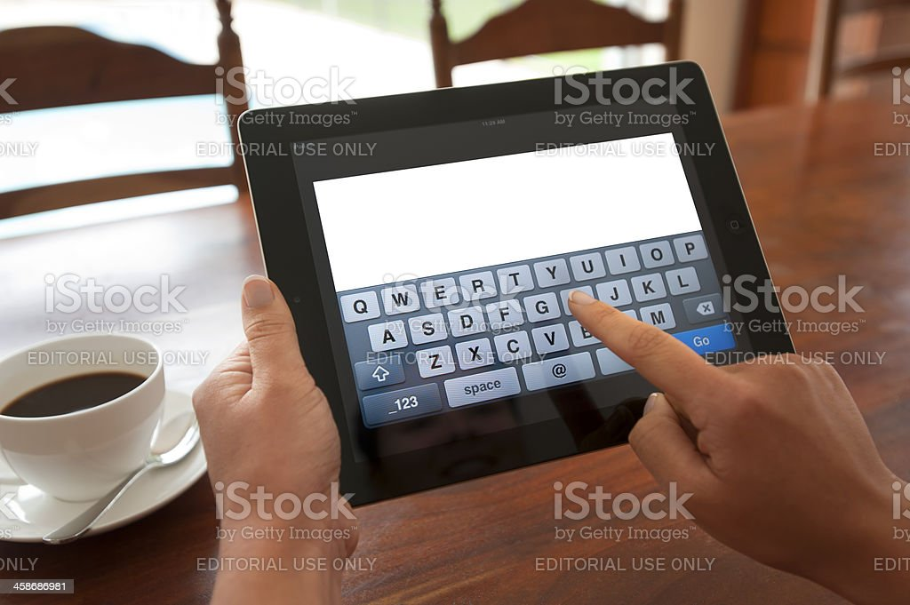 Woman typing on a blank digital keypad stock photo