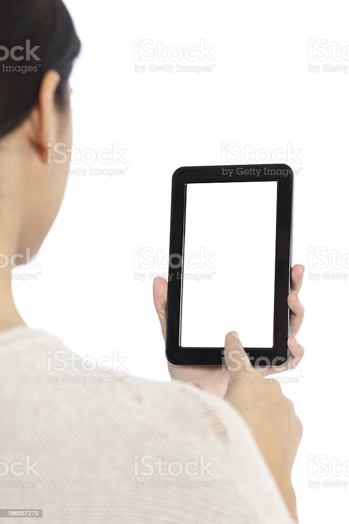 Woman typing on a blank tablet screen royalty-free stock photo