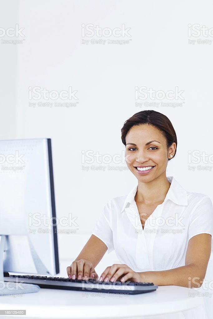 Woman Typing on Computer Keyboard In Office stock photo
