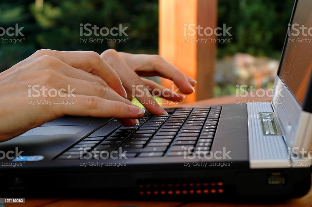 woman typing on her computer royalty-free stock photo