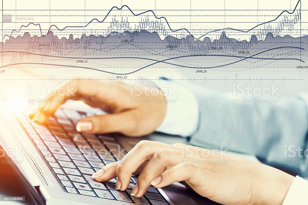 Woman typing on keyboard . Mixed media stock photo