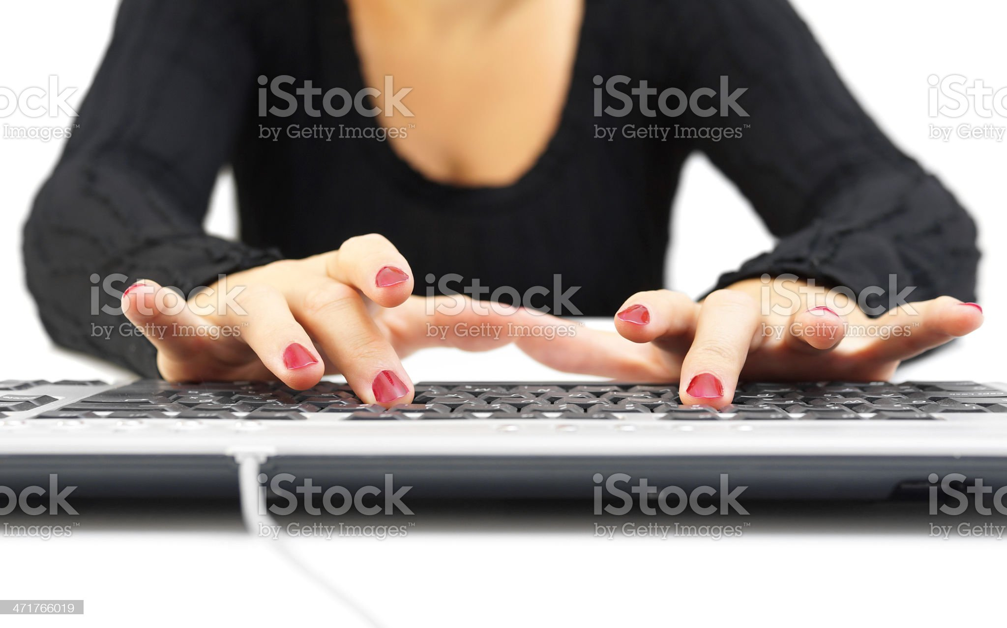 woman typing on keyboard royalty-free stock photo
