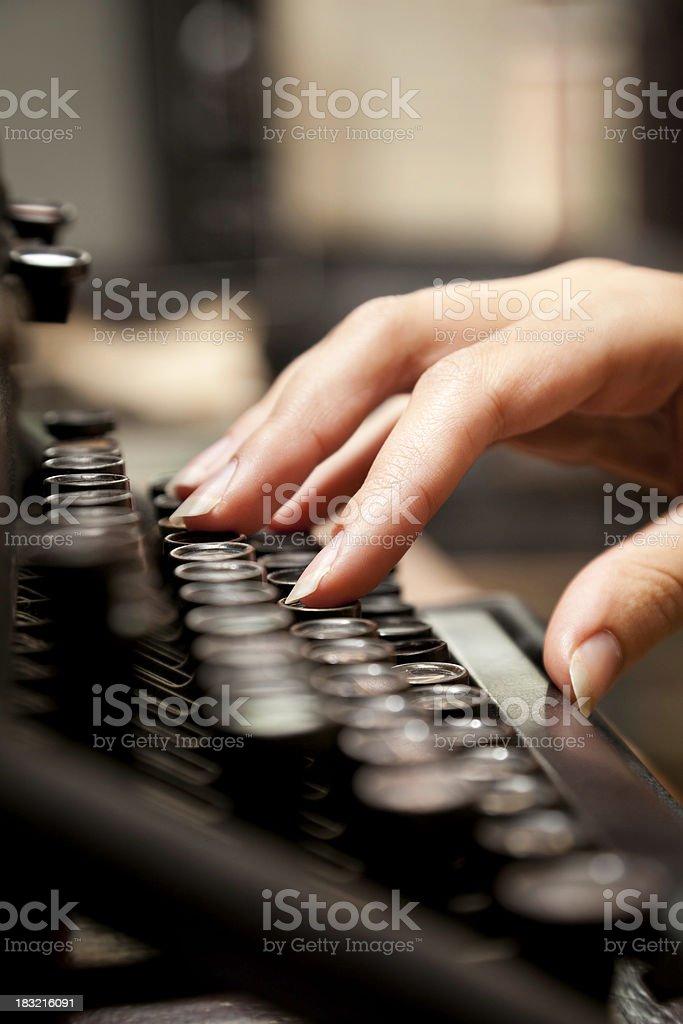 Woman Typing on Old-Fashioned Typewriter - Closeup royalty-free stock photo