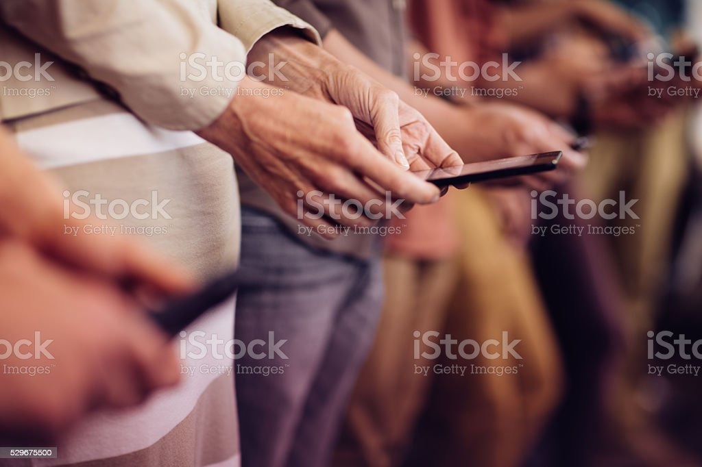 Woman typing on smartphone stock photo