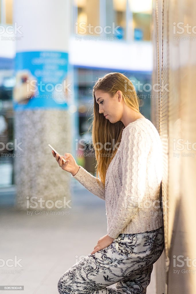Woman typing text message on mobile phone stock photo