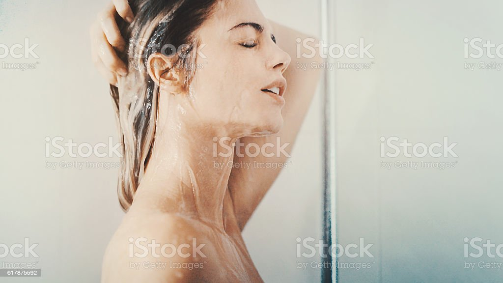 Woman under a relaxing shower. stock photo