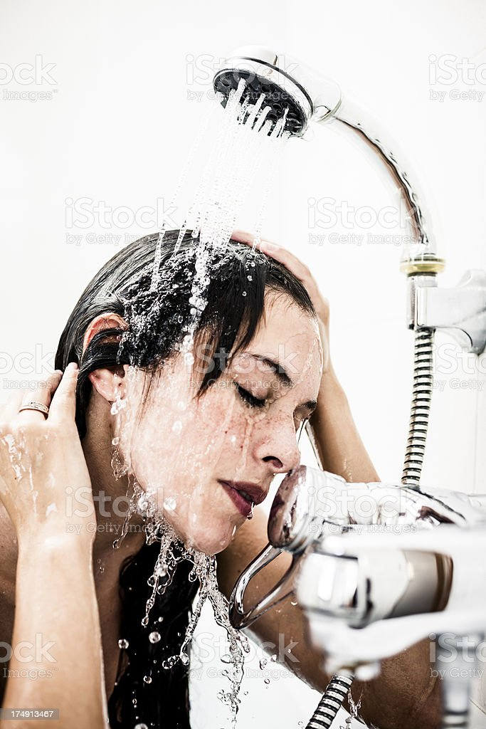Woman under shower royalty-free stock photo