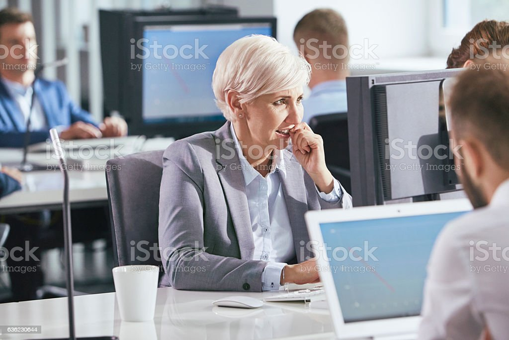 Woman under stress at work. Corporate business stock photo