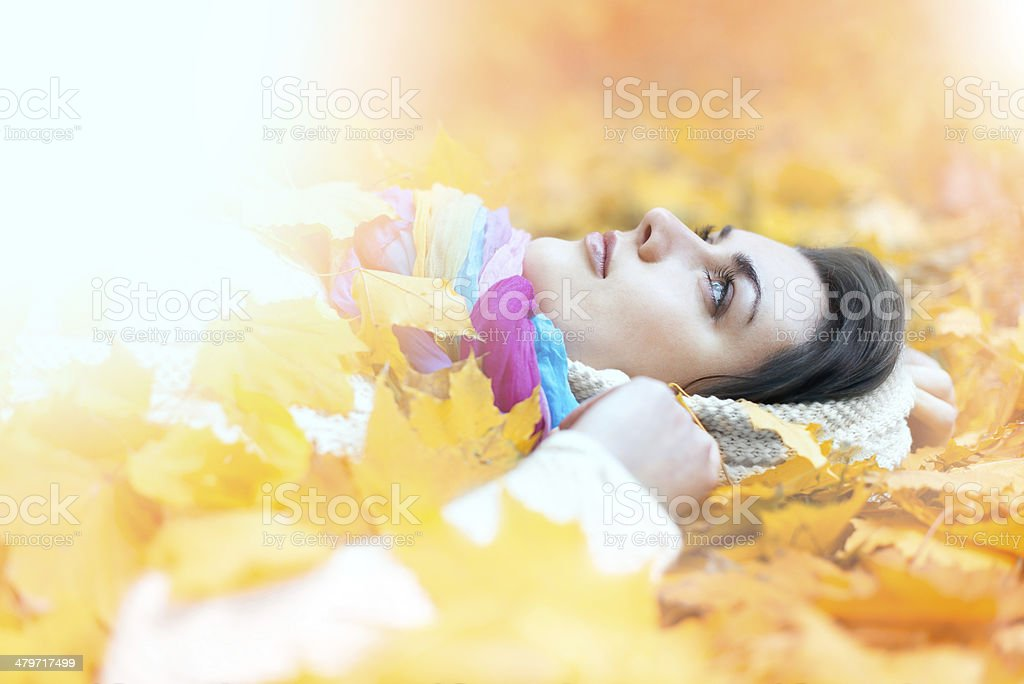 Woman under the leaves royalty-free stock photo