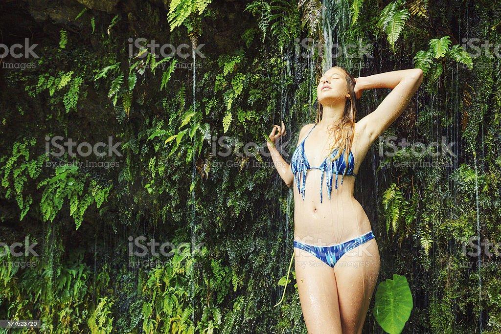 Woman underwaterfall in Hawaii stock photo