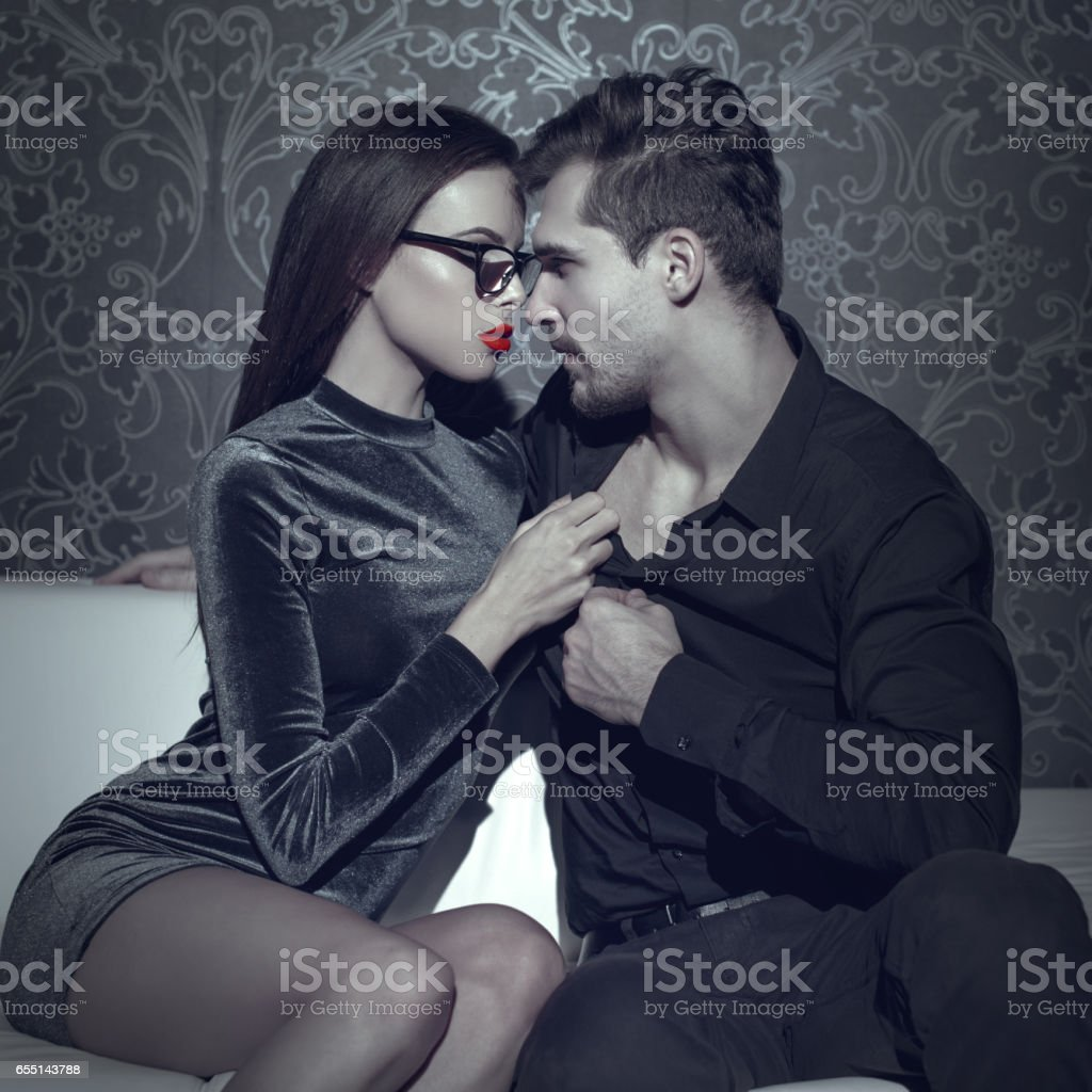 Woman undressing rich man shirt selective coloring stock photo