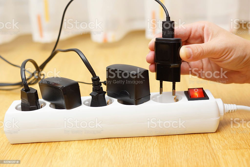 Woman unplugged plug to save on energy stock photo