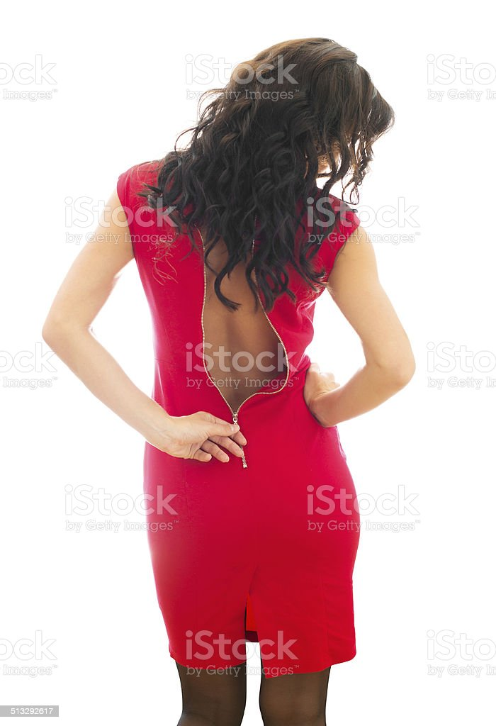 Woman unzips her red dress. Isolated on white. stock photo