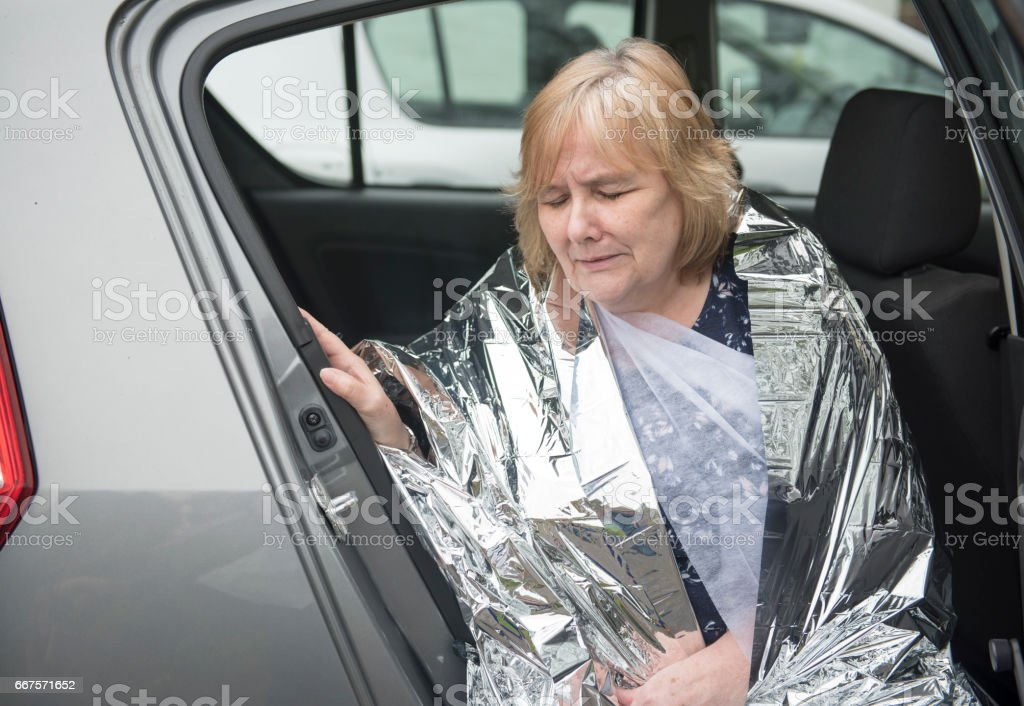Woman upset in a car accident stock photo