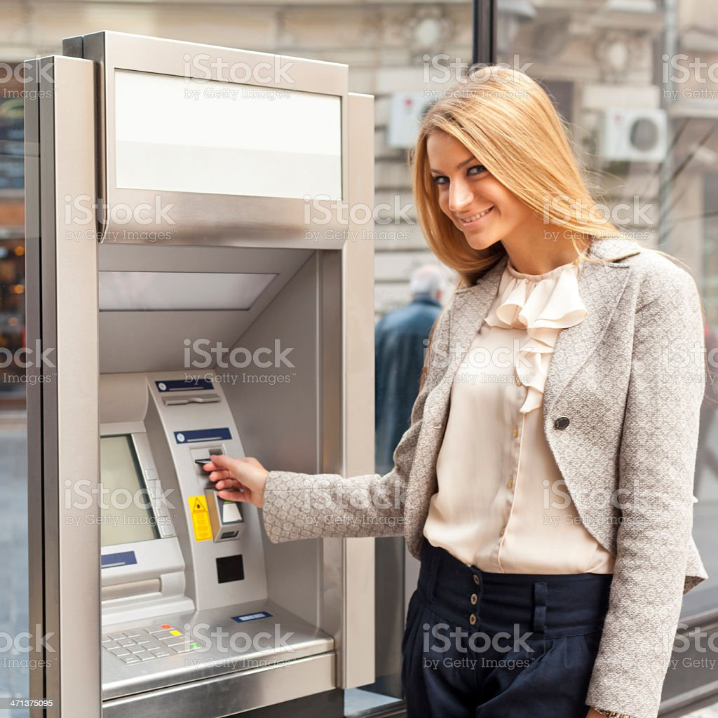 Woman use Bank ATM royalty-free stock photo