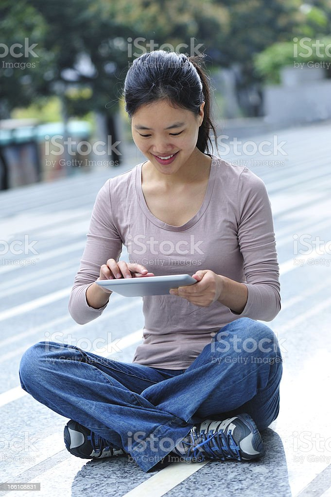 woman use digital tablet in city royalty-free stock photo