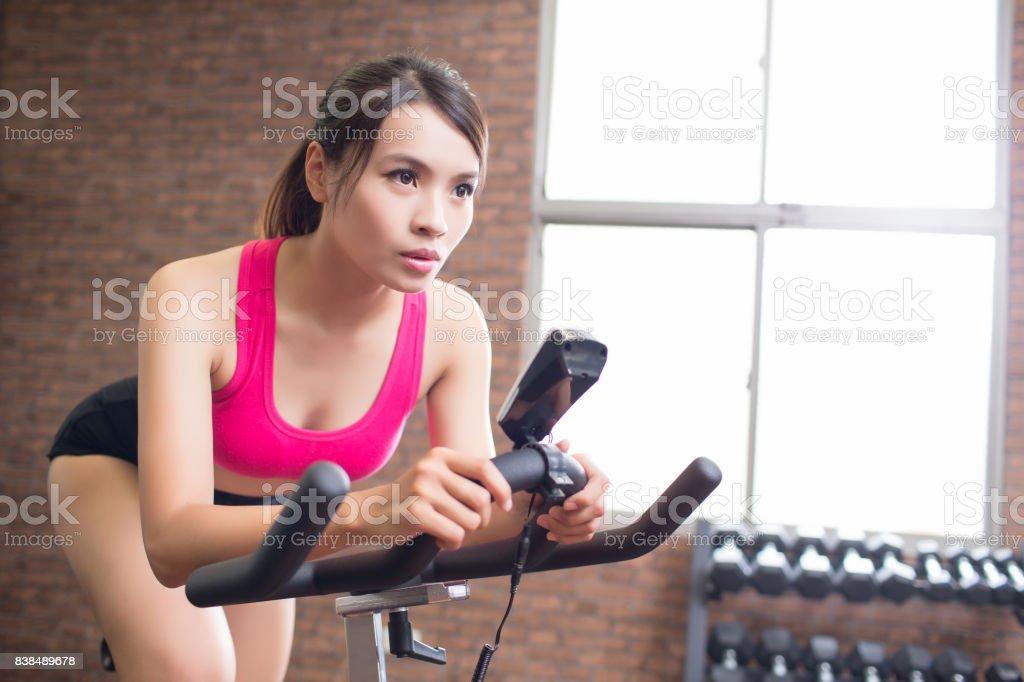 woman use exercise bike stock photo
