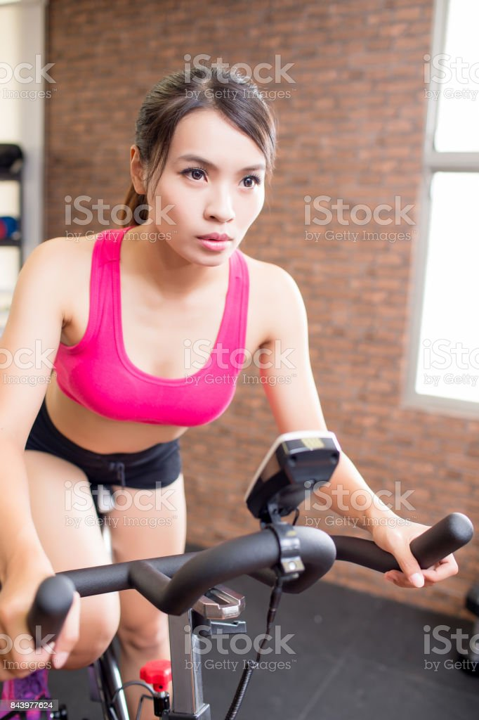 woman use gym flywheel stock photo
