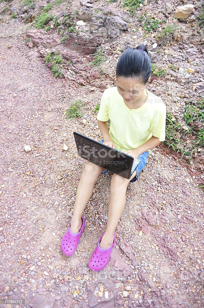 woman use laptop outdoor stock photo