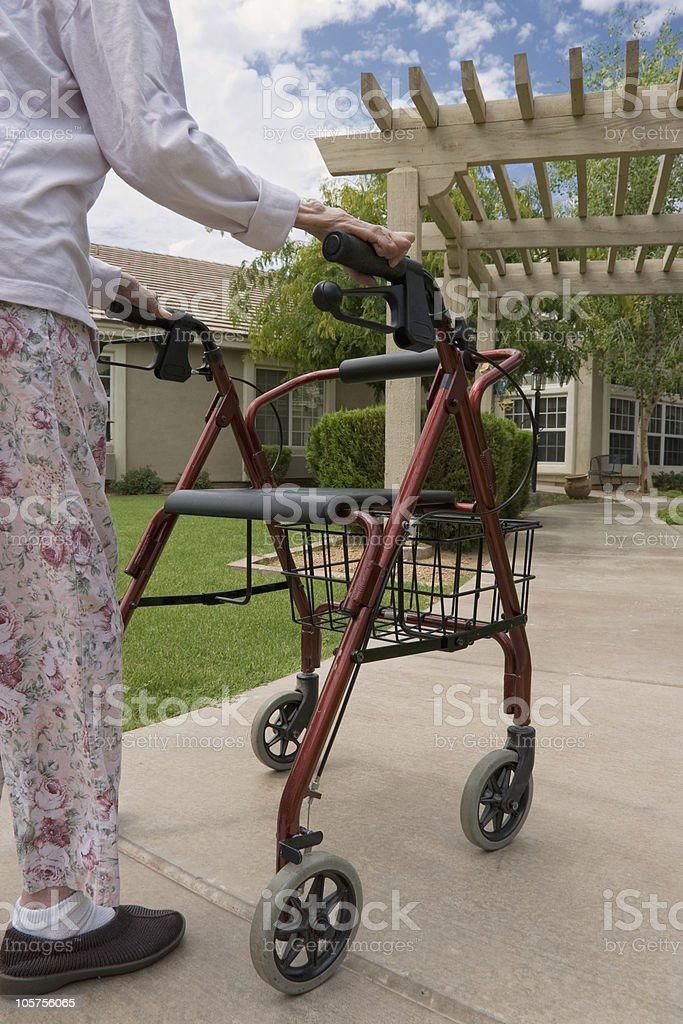 Woman uses her walker going back to nursing home royalty-free stock photo