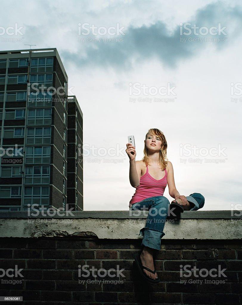 Woman using a camera telephone royalty-free stock photo