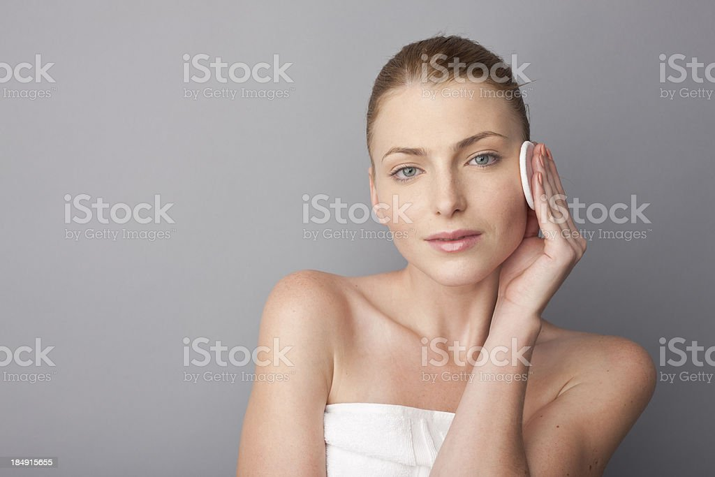 woman using a cosmetic pad stock photo