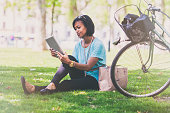 Woman using a digital tablet in the park