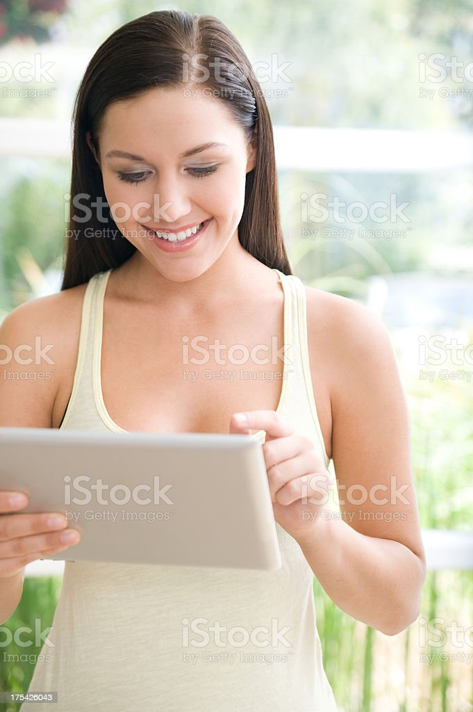 Woman using a digital tablet royalty-free stock photo