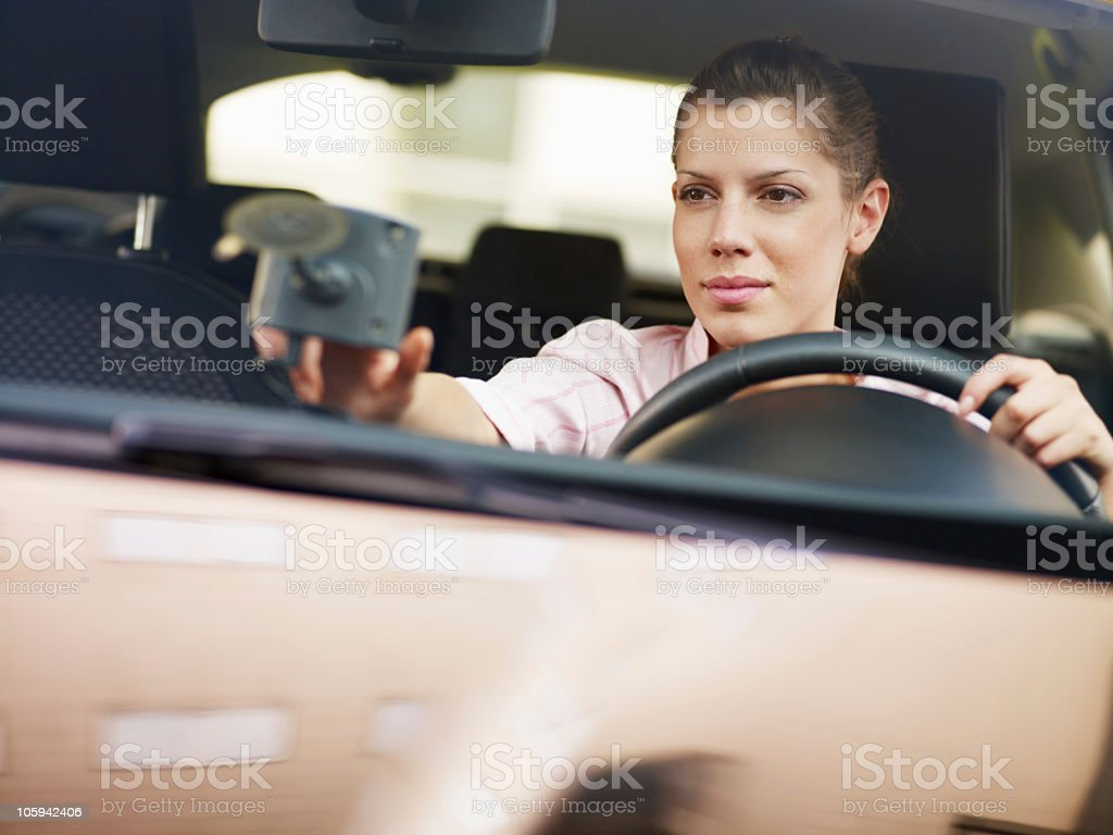 A woman using a global navigational system in her car royalty-free stock photo