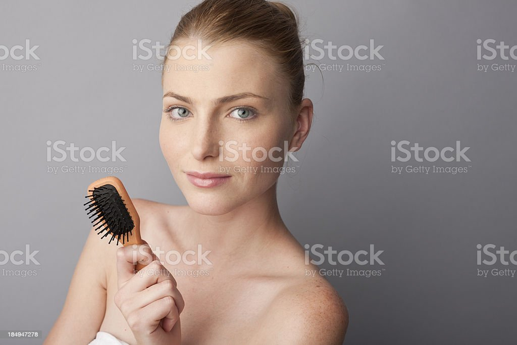 woman using a hair brush stock photo