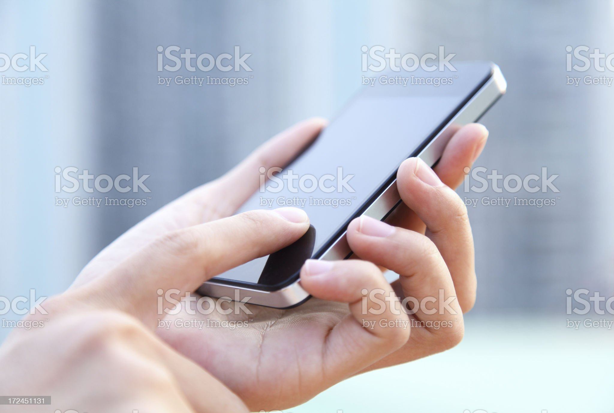 A woman using a large smartphone outdoors royalty-free stock photo